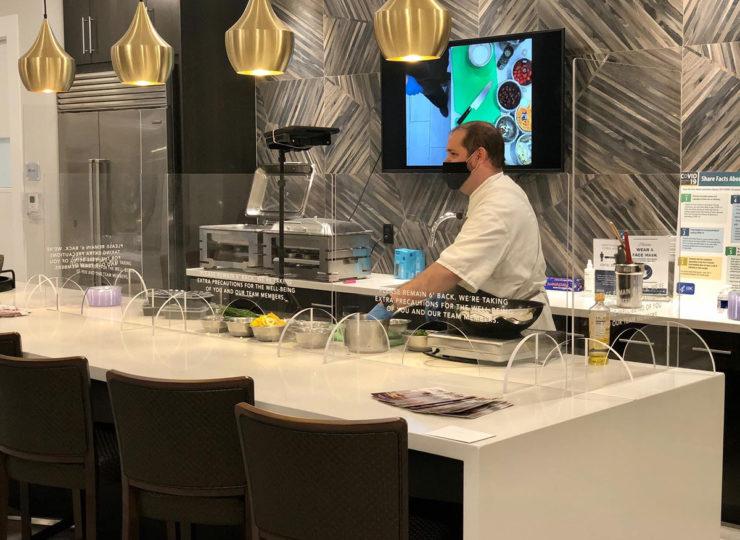 Chefs For Seniors Zack Behind Glass Bar