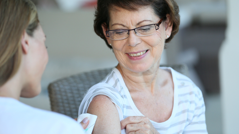 senior woman getting COVID booster shot
