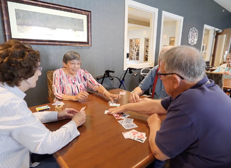 Traditions at Reagan Park Group of Residents Playing Cards
