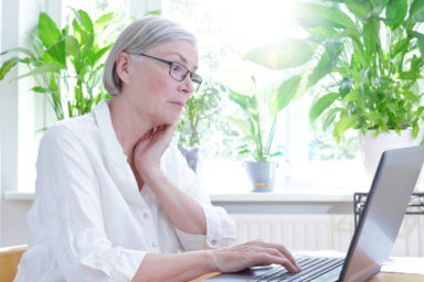 annoyed senior woman looking at a laptop (Credit: Agenturfotografin Dreamstime.com) For article, Ask Amy: My friend's husband is annoying