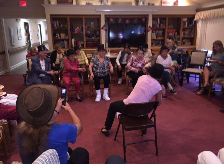 Summit Home Health Care Caregiver Entertaining Residents