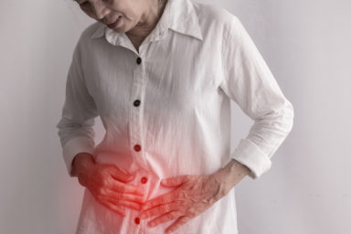 Asian senior adult woman with stomachache (Credit Nitchakul Sangphet Dreamstime.com) For article on senior adults with celiac disease