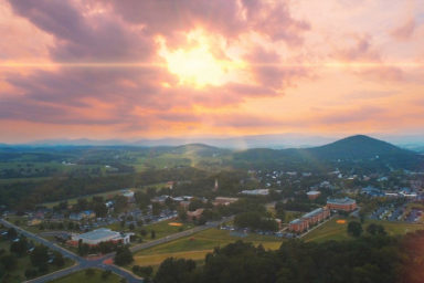 Bridgewater Retirement Community campus aerial view plus mountains and sunset